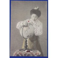 1900's Russo Japanese War time Postcard :  A Woman putting the sun flag on a globe